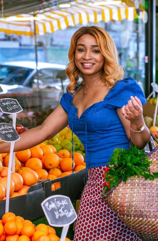 Malée Natural Science Lerato Umah-Shaylor of Lerato Foods Woman holder basket at fruit and vegetable stall with oranges in the background