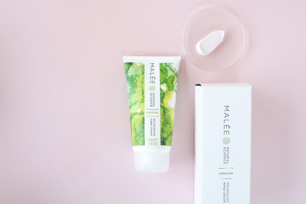 Malée Natural Science 75ml Verdure Nourishing hand cream with a white background and cream pasted in clear glass and