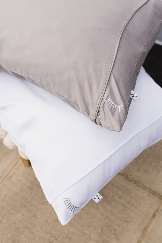 Malée Natural Science sleep time 100% bamboo nightire grey and white pillow case stacked on chair with beige background