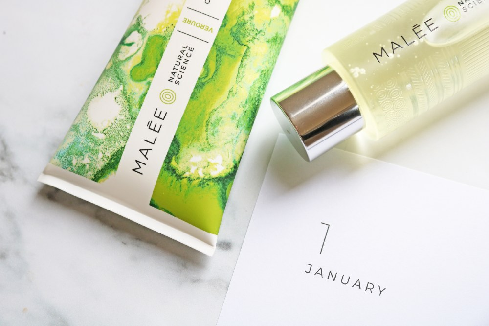 Malée Natural Science New year resolution 100ml Verdure Moisturising Oil 200ml Verdure Conditioning Body Cream placed close to a white sheet on which the word January is written